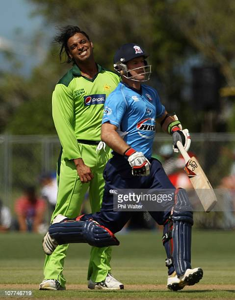 Shoaib Akhtar of Pakistan shows his frustration as Gareth Hopkins of the Aces runs during the Twenty20 trial match between Pakistan and the Auckland...