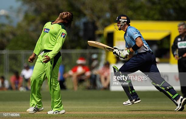 Shoaib Akhtar of Pakistan shows his frustration as Martin Guptill of the Aces runs during the Twenty20 trial match between Pakistan and the Auckland...