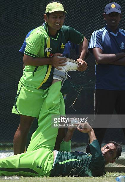 Shoaib Akhtar of Pakistan who has announced his retirement from international cricket has his leg stretched by a physio during a nets session at the...