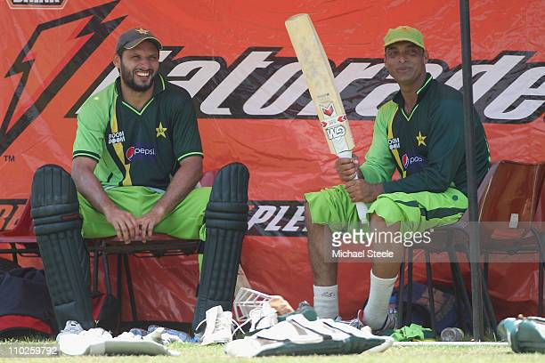 Shoaib Akhtar of Pakistan who has announced his retirement from international cricket alongside his captain Shahid Afridi during a nets session at...