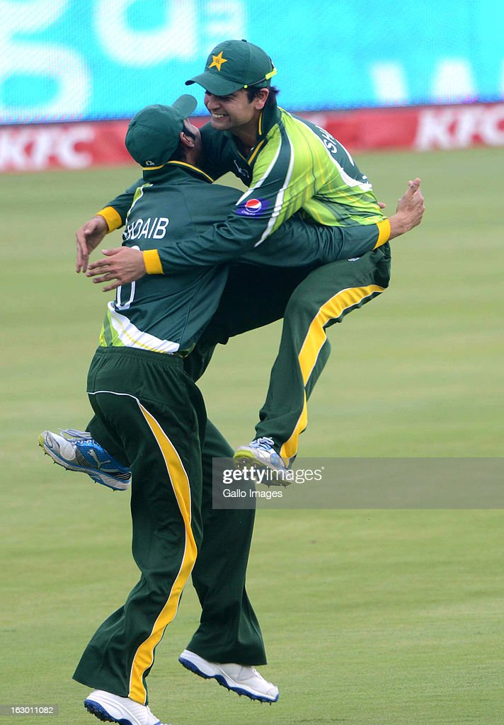 AFRICA - MARCH 03, Shoaib Malik and Ahmed Shehzad of Pakistan celebrate the wicket of Farhaan Behardien of South Africa during the 2nd T20 match between South Africa and Pakistan at SuperSport Park on March 03, 2013 in Pretoria, South Africa.