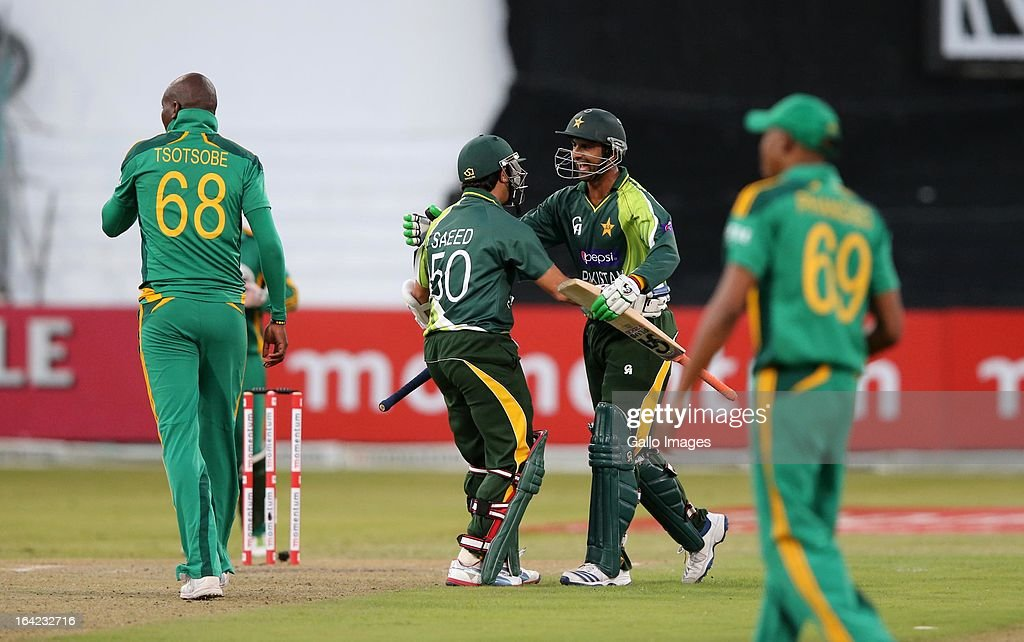 <a gi-track='captionPersonalityLinkClicked' href=/galleries/search?phrase=Shoaib+Malik&family=editorial&specificpeople=221455 ng-click='$event.stopPropagation()'>Shoaib Malik</a> and <a gi-track='captionPersonalityLinkClicked' href=/galleries/search?phrase=Saeed+Ajmal&family=editorial&specificpeople=2247219 ng-click='$event.stopPropagation()'>Saeed Ajmal</a> celebrate the victory during the 4th Momentum One Day International match between South Africa and Pakistan at Sahara Stadium Kingsmead on March 21, 2013 in Durban, South Africa.