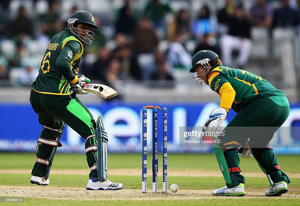 <a gi-track='captionPersonalityLinkClicked' href=/galleries/search?phrase=Shoaib+Malik&family=editorial&specificpeople=221455 ng-click='$event.stopPropagation()'>Shoaib Malik</a> of Pakistan looks on after he is bowled by JP Duminey of South Africa during the ICC Champions Trophy Group B match between Pakistan and South Africa at Edgbaston on June 10, 2013 in Birmingham, England.