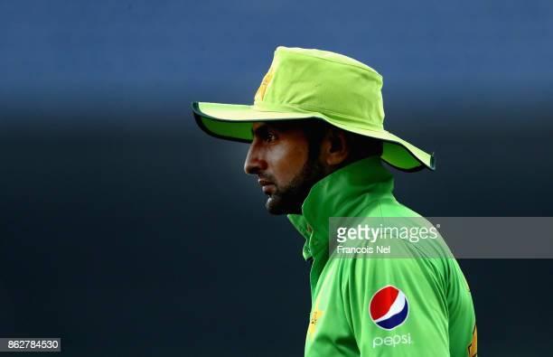 Shoaib Malik of Pakistan looks on during the third One Day International match between Pakistan and Sri Lanka at Zayed Cricket Stadium on October 18...