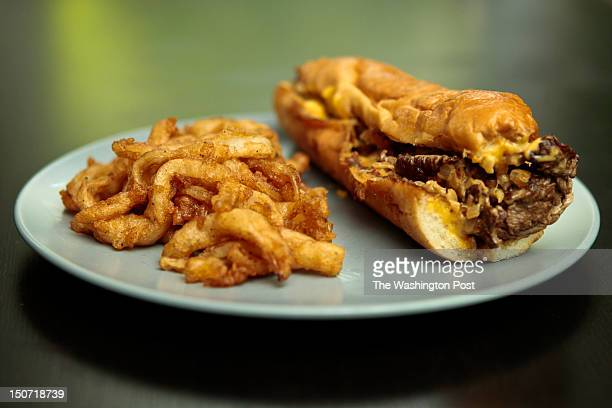 'Shock G' cheesesteak which contains onethird pound of sliced ribeye a generous helping of American and Provolone cheeses and grilled onions on a...