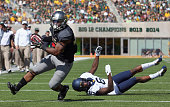 Shock Linwood of the Baylor Bears carries the ball to score a touchdown against Dravon AskewHenry of the West Virginia Mountaineers in the second...