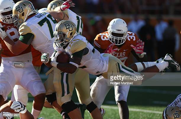 Shock Linwood of the Baylor Bears dives for a touchdown against the Texas Longhorns at Darrell K RoyalTexas Memorial Stadium on October 4 2014 in...