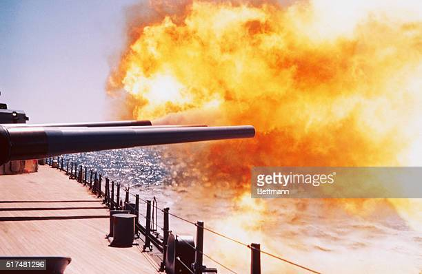 Shock waves agitate the ocean's surface as the battleship USS New Jersey fires her 16inch guns during sea trials in the Atlantic on April 16th...