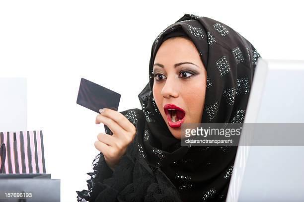 Shocked Arabic girl shopping on the internet