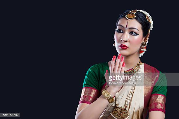 Shocked Bharatanatyam dancer over black background