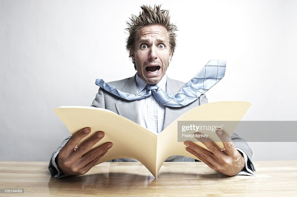 Shocked Businessman Office Worker Opening File Folder at Desk : Stock Photo