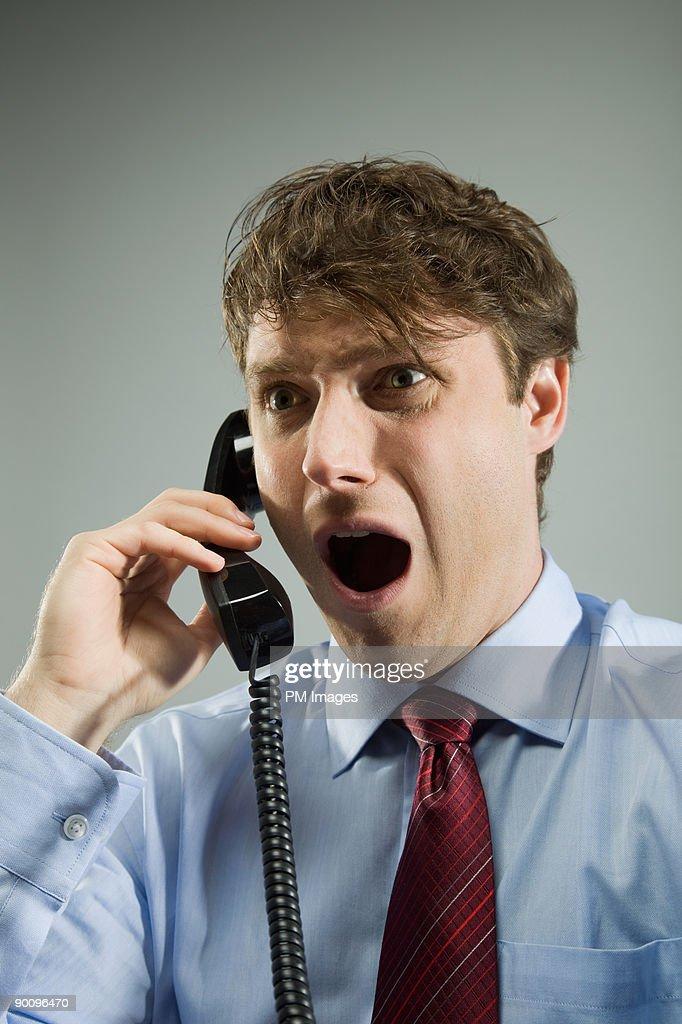 Shocked Businessman on Phone : Stock Photo