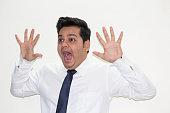 Shocked businessman screaming