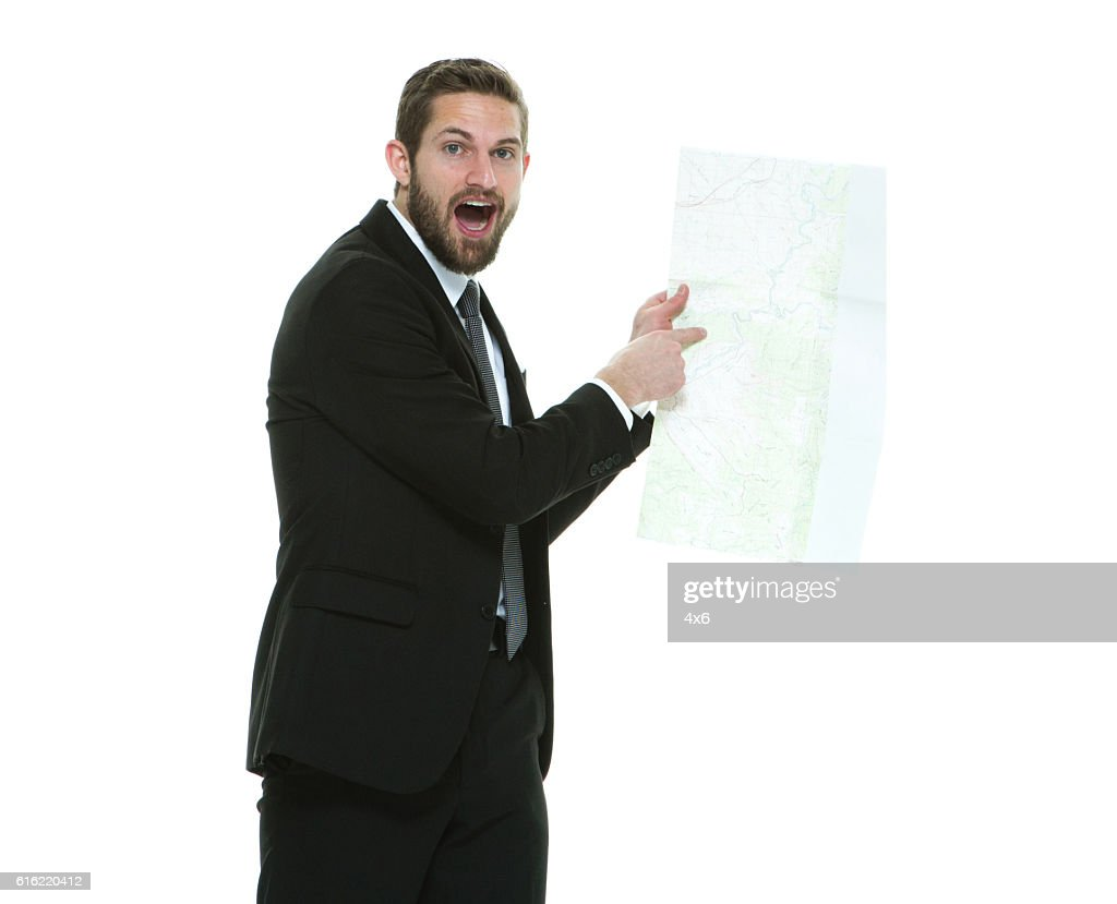 Shocked businessman pointing at map : Stock-Foto
