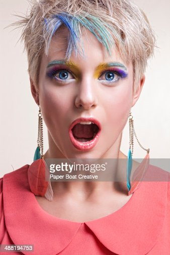 Shocked colorful woman with colorful hair and eyes