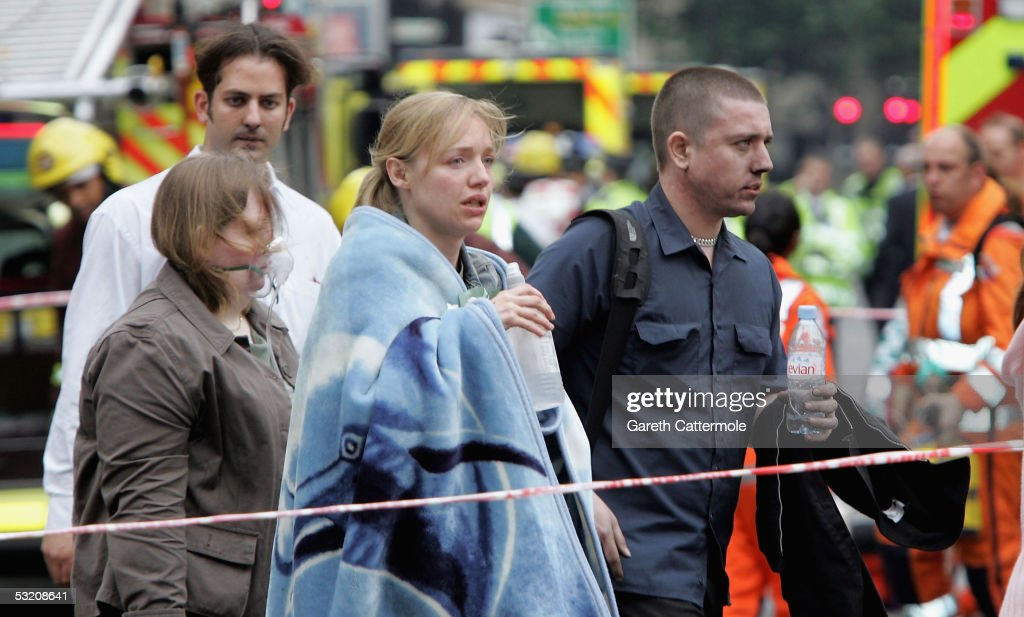 Shocked commuters with blackened faces walk away from Edgware Road underground station after several bomb blasts ripped across London's underground network on July 7, 2005 in London, England. Three explosions on the underground left at least 37 people dead, and many more injured. Prime Minister Tony Blair who returned from the G8 Summit described the attack as 'barbaric'.