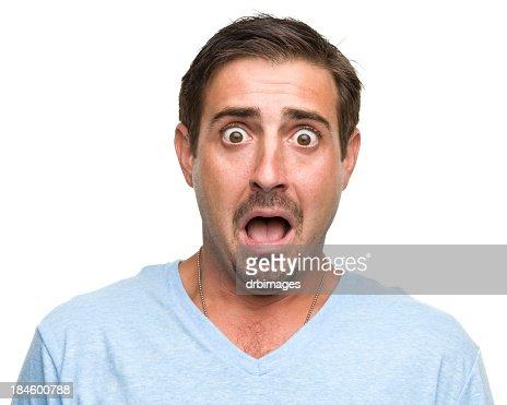 Shocked gasping young man wearing blue shirt