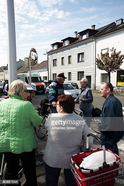 Shocked inhabitants of Amstetten discuss in front of the house where a father imprisoned his daughter for 24 years and had seven children with her on...