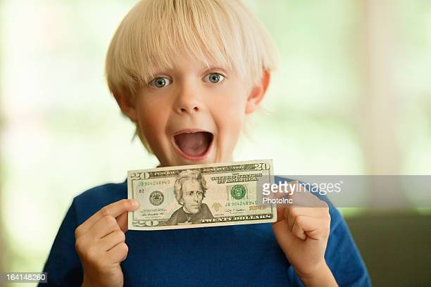 Shocked Little Boy With A Twenty Dollar Bill