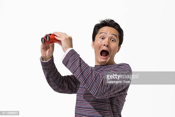 Shocked Man Holding Binocular