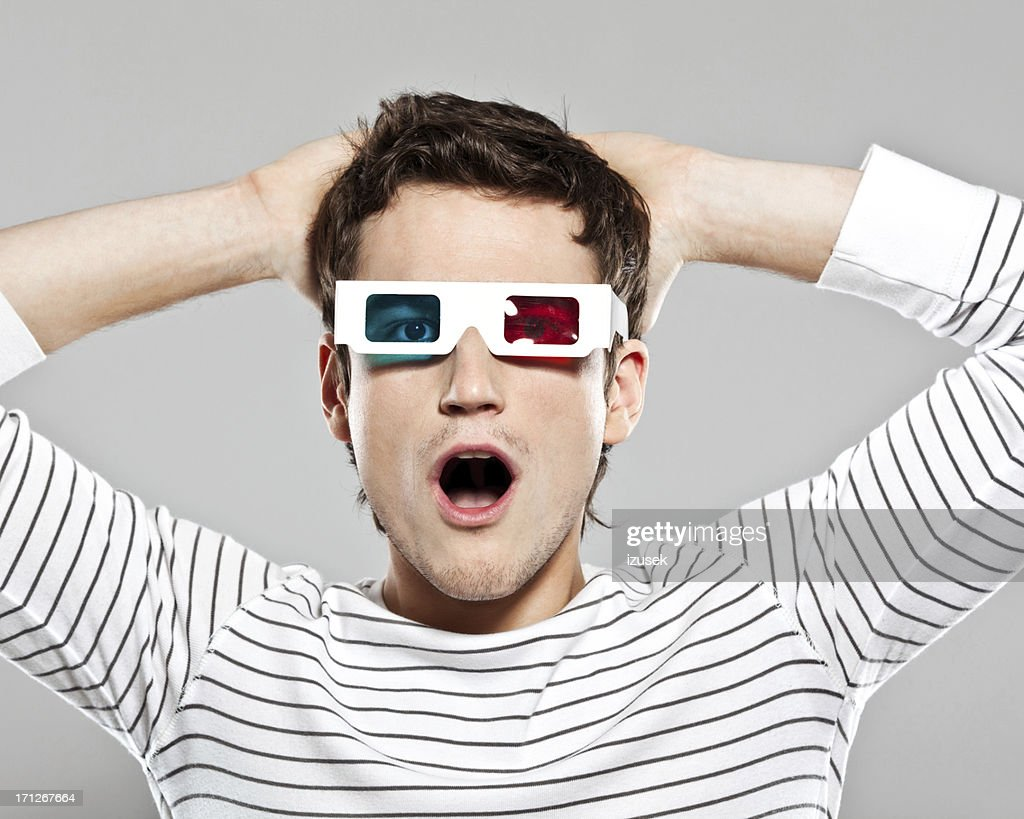 Shocked man wearing 3D glasses