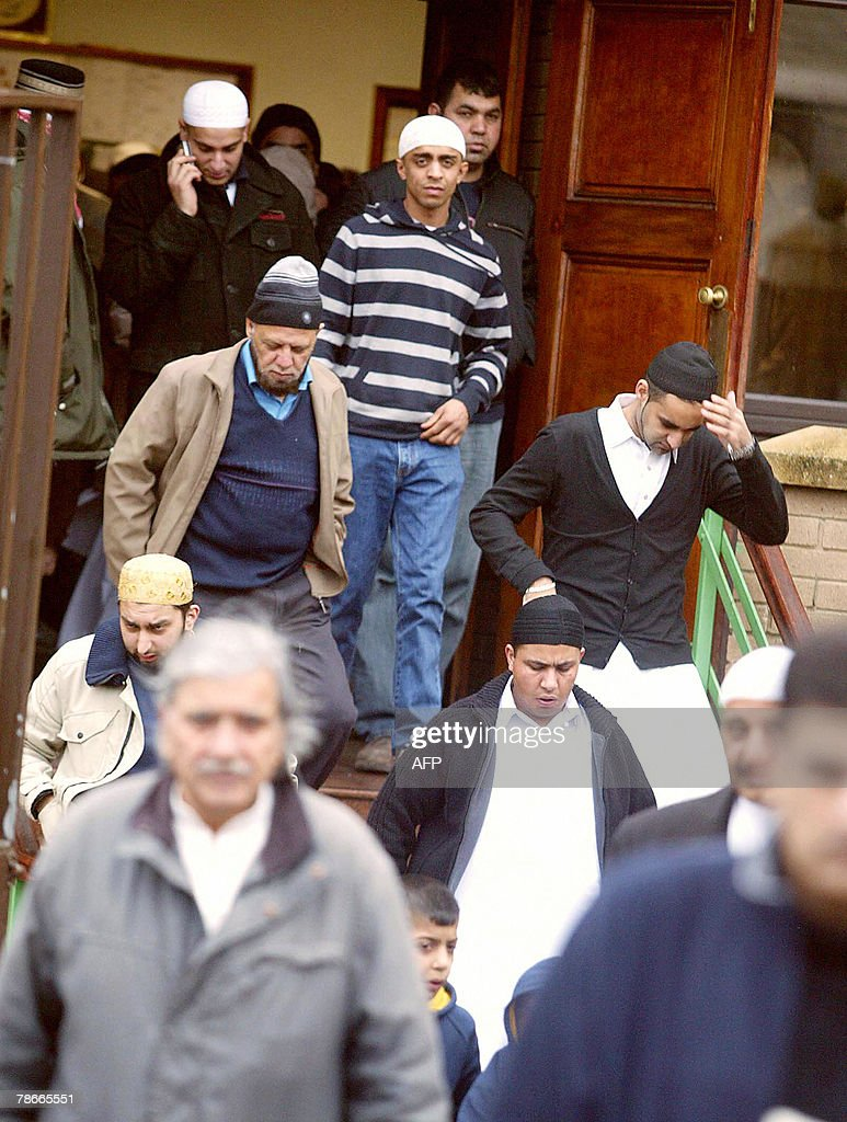 Shocked Muslim residents leave the Mosque in Bradford, Yorkshire, England, 28 December 2007 at the end of Friday prayers following the assassination of former Pakistani Prime Minister Benazir Bhutto, 27 December. Britain strengthened its advice to travellers to Pakistan today, warning against 'all but essential travel' following the death of Benazir Bhutto.The Foreign Office said it was also advising travellers already in Pakistan to stay indoors 'until the situation becomes clearer'. AFP PHOTO/TONY SPENCER