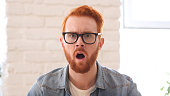 Shocked nad Confused Unsatisfied Man with Beard and Red Hairs, Open Mouth
