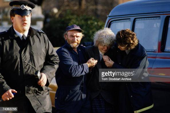 A shocked passenger receives assistance after a rail crash near Clapham Junction in London in which 35 people were killed and over 100 injured...