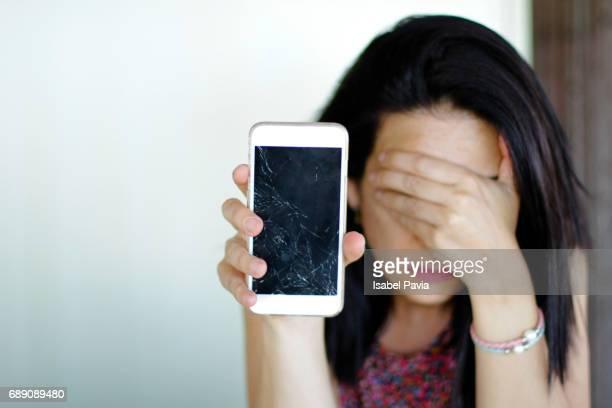 Shocked Woman Holding Broken Smart Phone