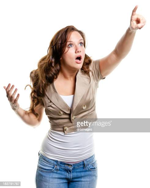 Shocked Young Woman Pointing Up
