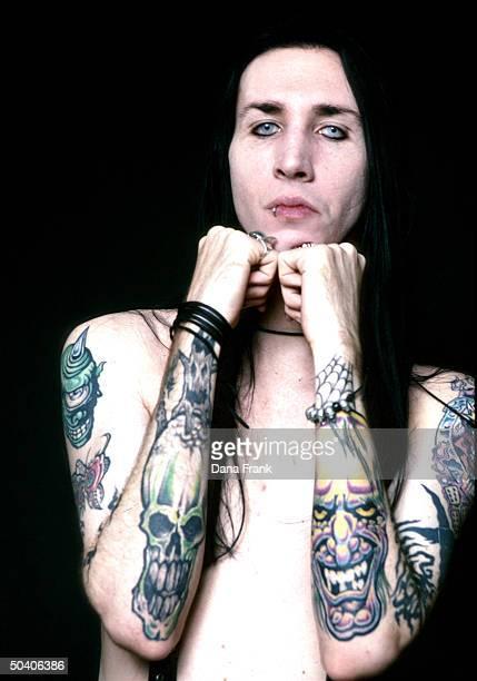 Shockrocker Marilyn Manson w tattooed arms