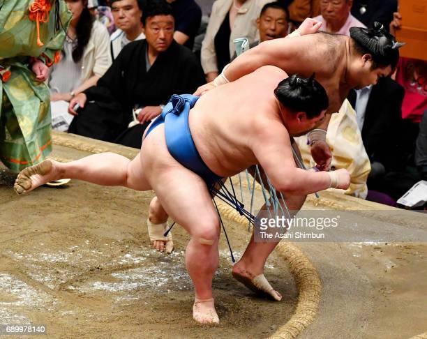 Shodai throws sekiwake Takayasu to win during day fourteen of the Grand Sumo Summer Tournament at Ryogoku Kokugikan on May 27 2017 in Tokyo Japan