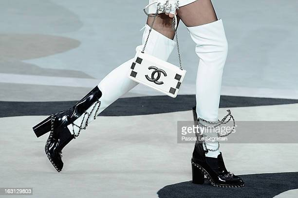 A shoe and bag detail are seen as a model walks the runway during Chanel Fall/Winter 2013 ReadytoWear show as part of Paris Fashion Week at Grand...