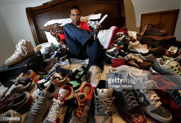 Shoe collector Anton Murphy poses with his rare sneaker collections at his house in Chicago January 14 2007