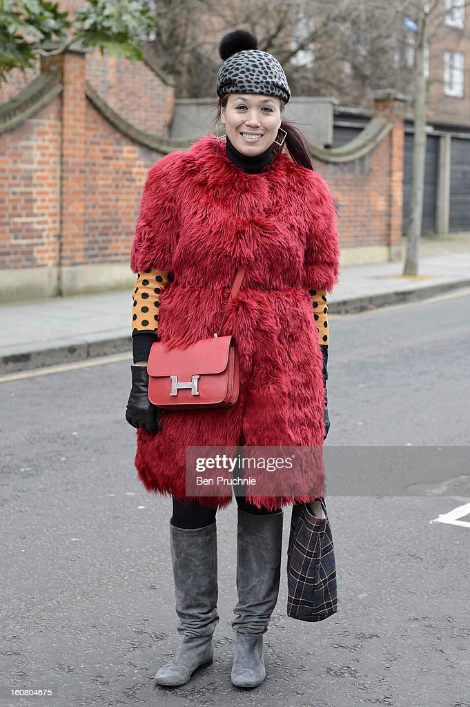 Shoe designer Alice (35) poses wearing vintage earrings, CA4lA hat, Marni jacket, Missoni jumper, Constance bag, Longchamp bag and unbranded boots in Notting Hill on February 6, 2013 in London, England.