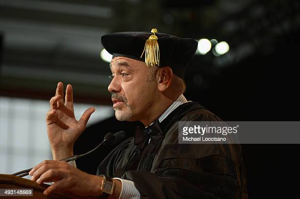 Shoe designer Christian Louboutin receives an honororary degree during the Fashion Institute of Technology's 69th Commencement at Javits Center on...