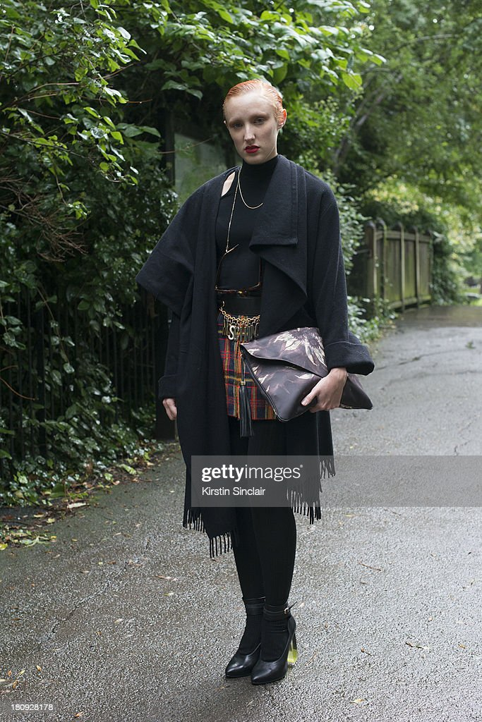 Shoe designer for Mista.com Georgie Bee wears Mista shoes and bag, Vintage skirt and coat, Morgan top and a Moschino belt on day 5 of London Fashion Week Spring/Summer 2013, at Somerset House on September 17, 2013 in London, England.