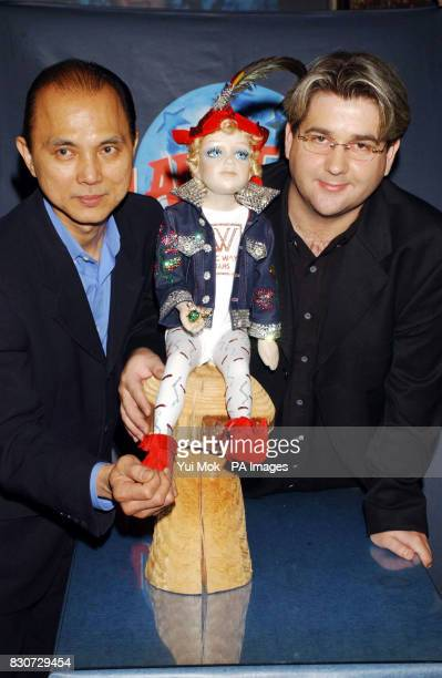 Shoe designer Jimmy Choo who designed the elf's boots and Eric Way designer of the elf's outfit during a photocall at Planet Hollywood London * The...