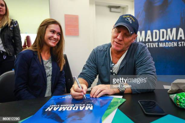 Shoe designer Steve Madden poses and signs autographs for fans at University of Michigan on October 11 2017 in Ann Arbor Michigan