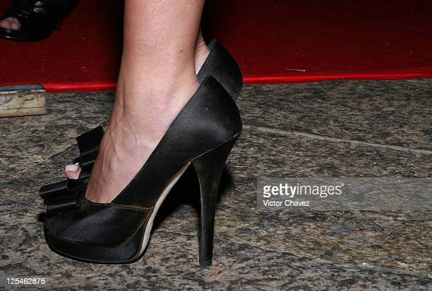 A shoe detail of singer Anahi is seen during the Cantandole A Veracruz benefit concert at Voila Antara on October 18 2010 in Mexico City Mexico