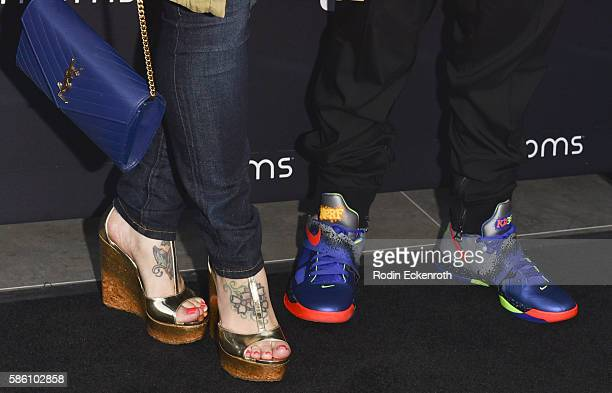 Shoe detail stylist Urbana Lawrence and composer Philip Lawrence attend 4moms Launches SelfInstalling Car Seat at Petersen Automotive Museum on...
