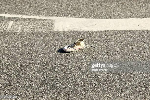 Shoe on asphalt