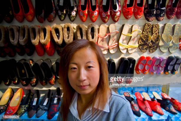 Shoe seller in shop in Dazhalan.
