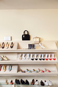 Footwear on display rack in shoe store