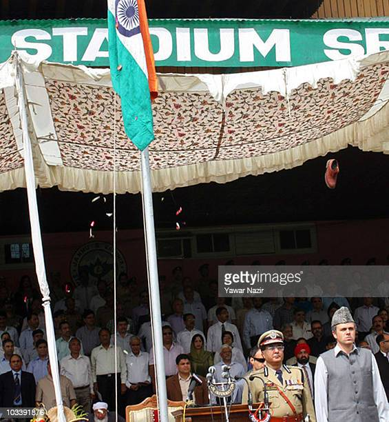 A shoe thrown by a police officer from the VIP gallery misses Kashmir's chief minister Omar Abdullah's head during India's Independence Day...