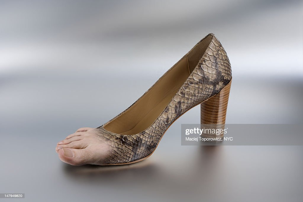 Shoe turning into foot : Stock Photo