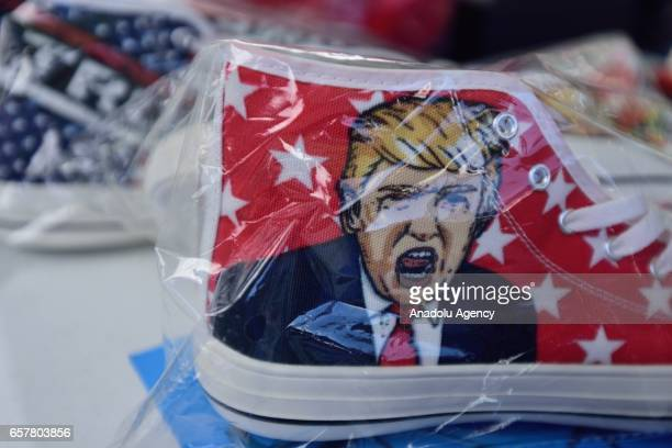A shoe with a rendering of President Donald Trump is pictured for sale at a 'Make America Great Again' rally in Salem Oregon United States on March...