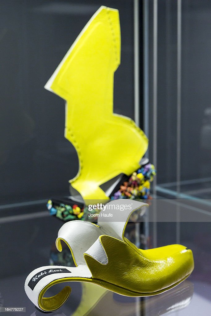 A shoe with the name 'Banana' designed for Whoopi Goldberg by Kobi Levi and shoe with the name 'Lady Gaga Shoe' designed for Lady Gaga by Ben Naaem at the exhibition: 'Starker Auftritt: Experimentelles Schuh Design' (the title is a play on words, as it means both 'Strong Appearance' and 'Strong Step', coupled to 'Experimental Show Design') at the Grassi Museum on March 27, 2013 in Leipzig, Germany. The exhibition features over 200 pairs of shoes, many of them designed for celebrities and which challenge traditional notions of shoe design. The exhibition will run until September 28, 2013.