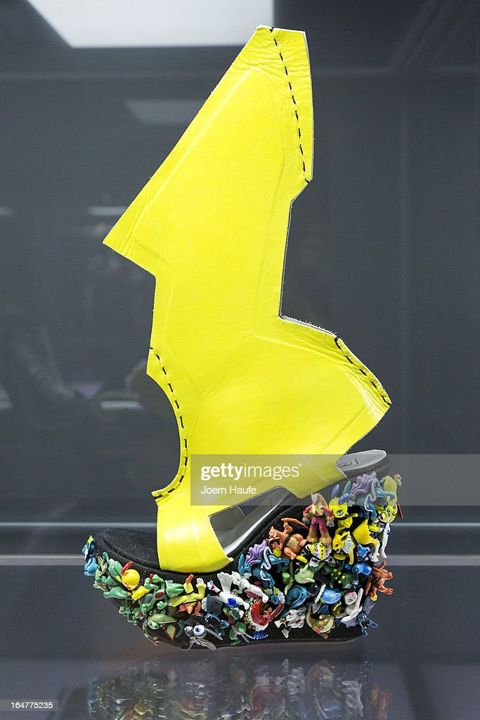 A shoe with the name 'Lady Gaga Shoe' designed for Lady Gaga by Ben Naaem at the exhibition: 'Starker Auftritt: Experimentelles Schuh Design' (the title is a play on words, as it means both 'Strong Appearance' and 'Strong Step', coupled to 'Experimental Show Design') at the Grassi Museum on March 27, 2013 in Leipzig, Germany. The exhibition features over 200 pairs of shoes, many of them designed for celebrities and which challenge traditional notions of shoe design. The exhibition will run until September 28, 2013.