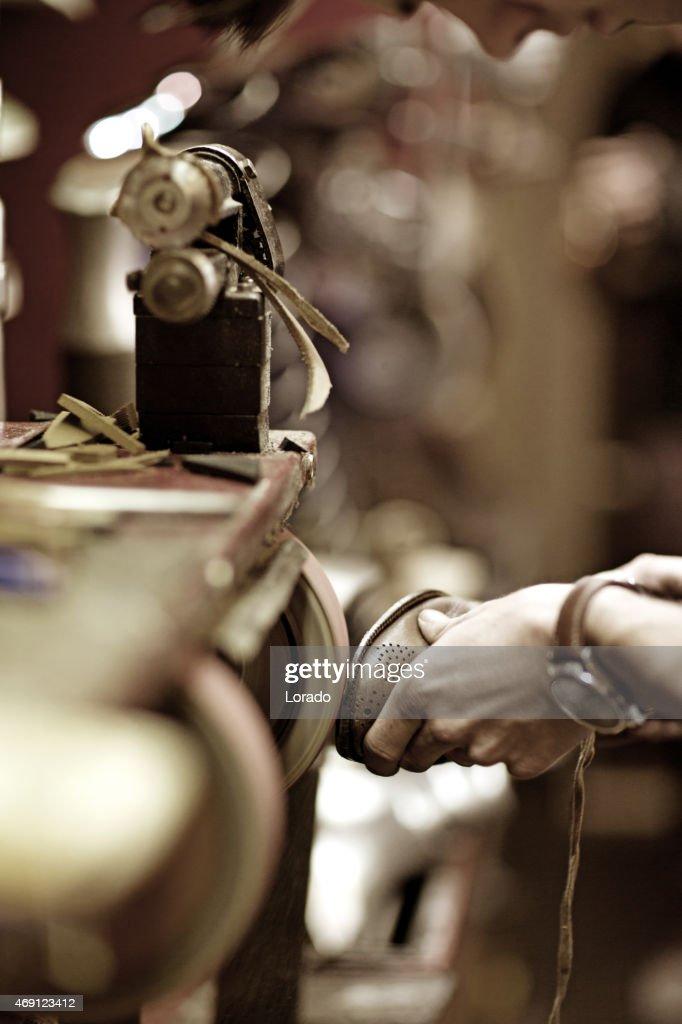 shoemaker polishing shoe